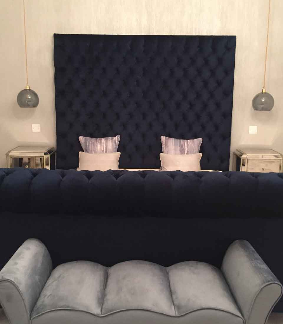 Bespoke navy velvet master bed with buttoned headboard